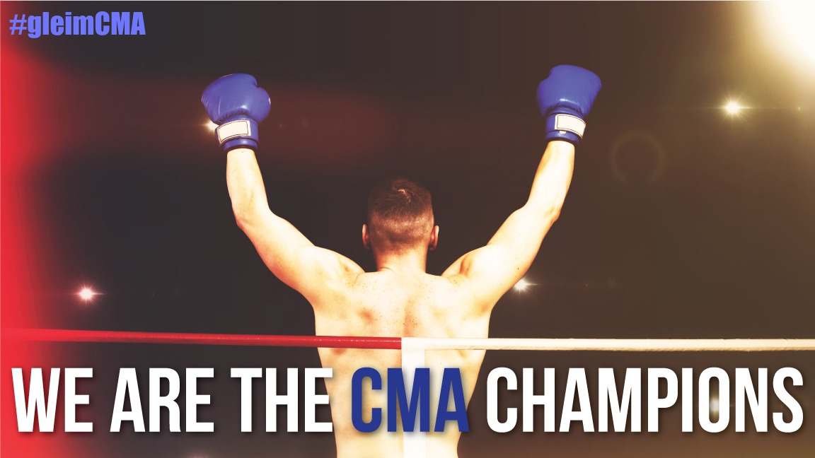 raising hands for being the CMA champions