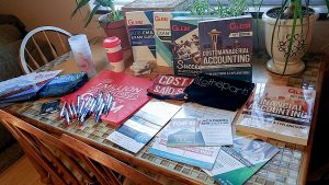 Braylee's Gleim Campus Rep marketing materials toolkit, arranged on a table.