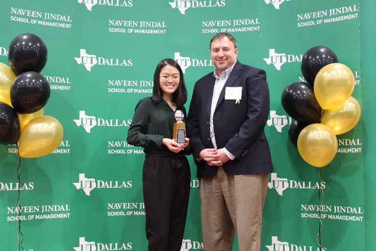 Angie Wong receiving an OWLIE with Professor Joseph Mauriello