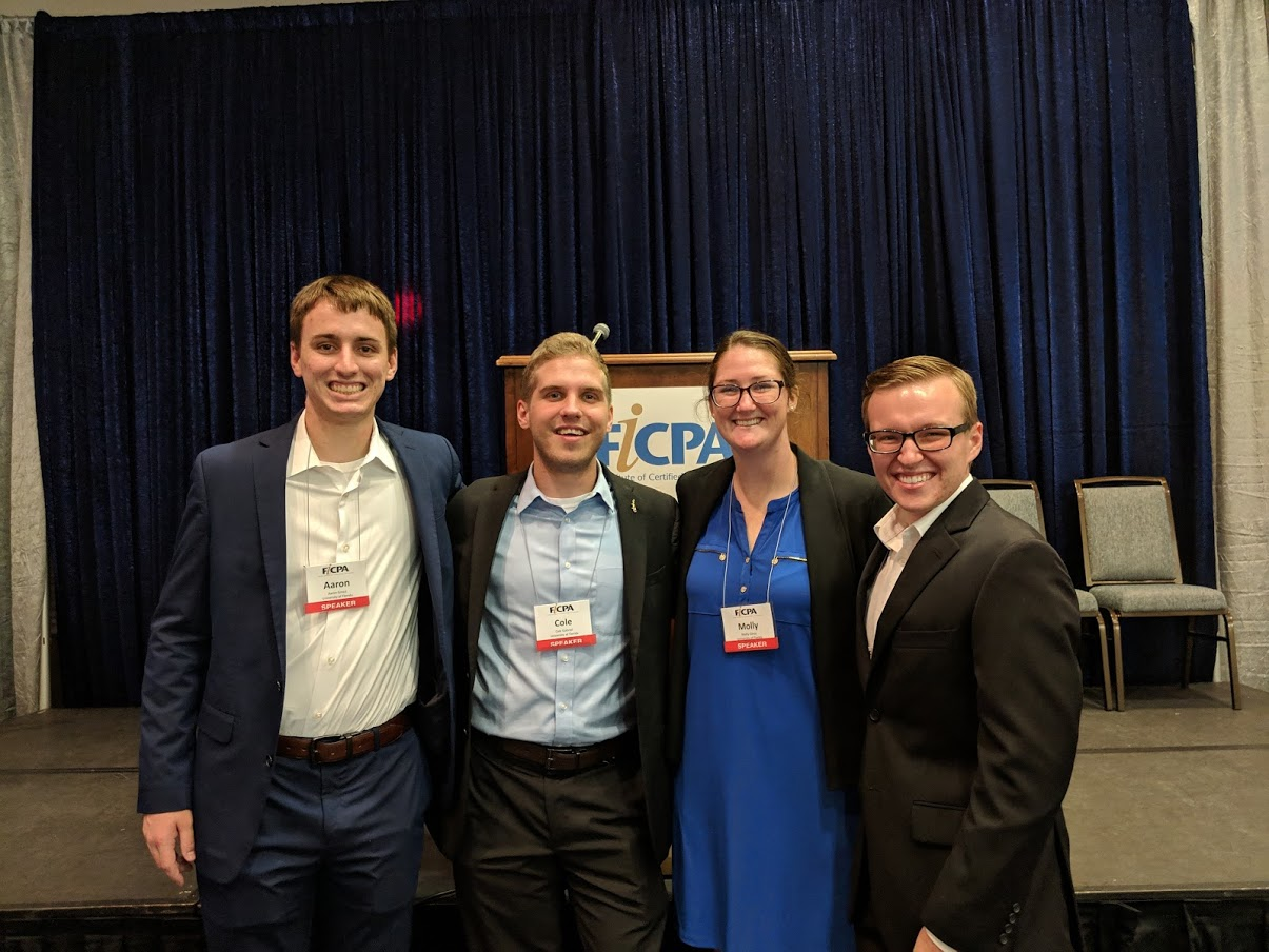 Cole standing with his 3 fellow FICPA presenters