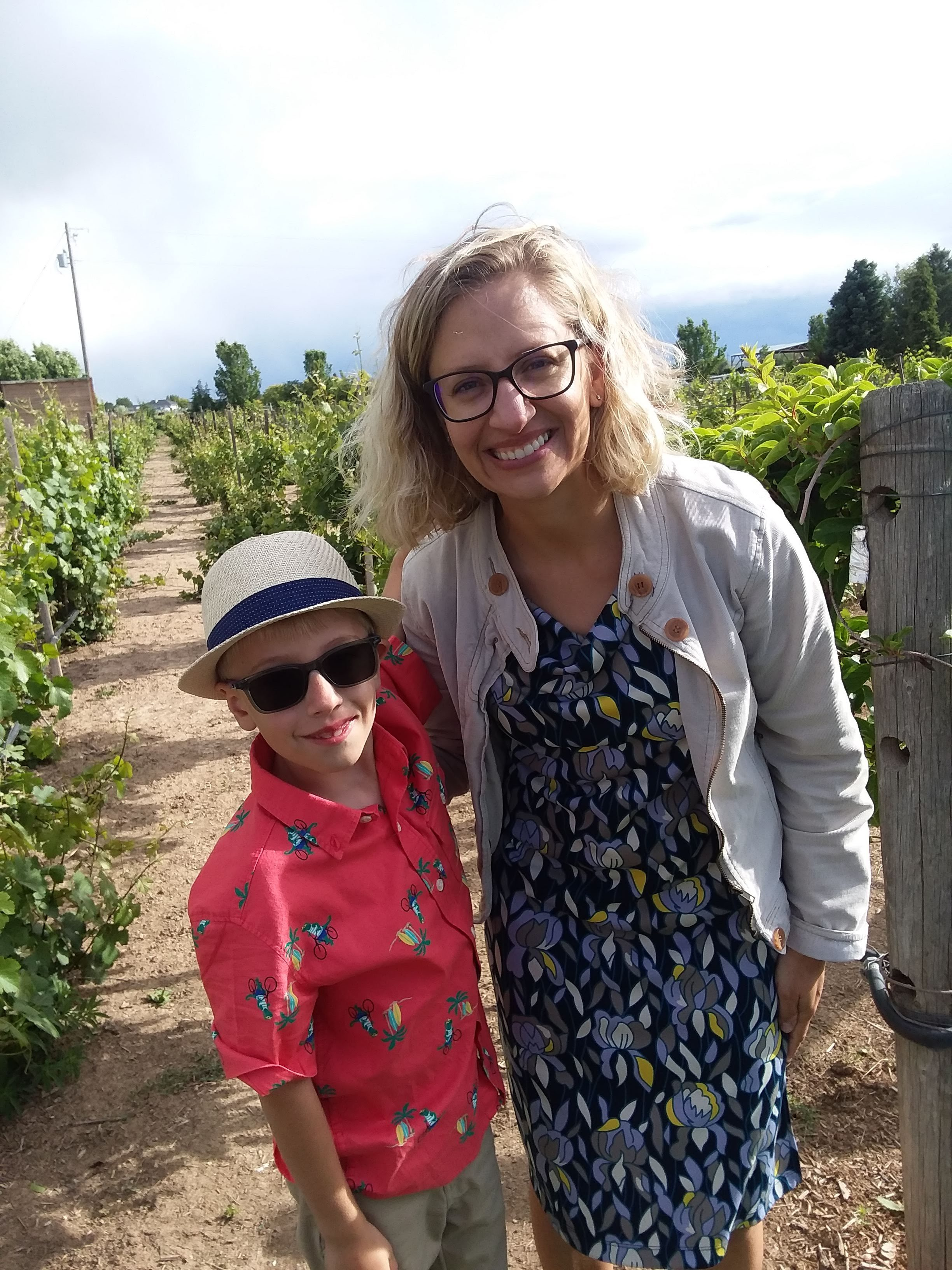 Casie Cook visits a farm with her son.