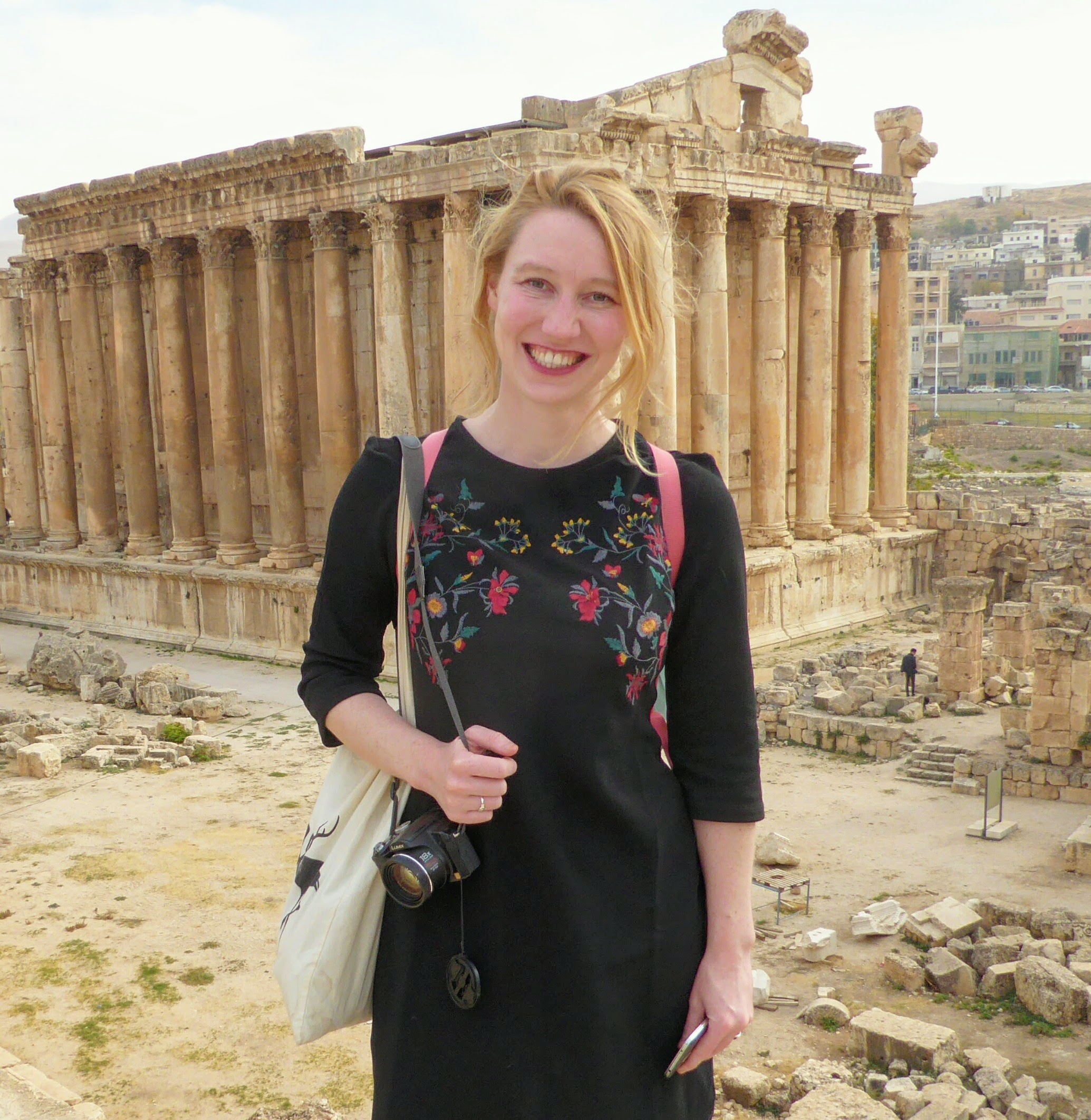 Brigitte de Graaff stands in front of Greek Parthenon