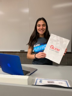 Jeanette Elia with her Gleim swag about to give a presentation for fellow classmates