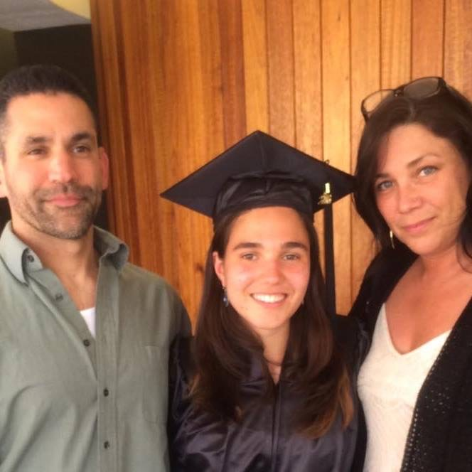 Jeanette Elia in her graduation gown with her family