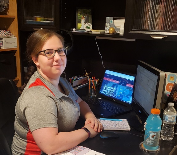 Gleim Personal Counselor Soncera Keene smiling at her desk at home during COVID-19